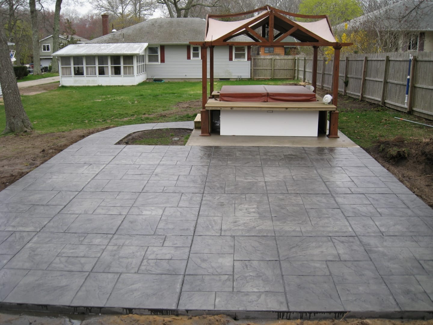 Random Slate Concrete Patio For A Hot Tub
