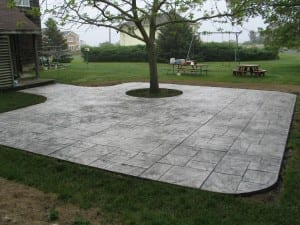 Random slate patio with tree in the middle